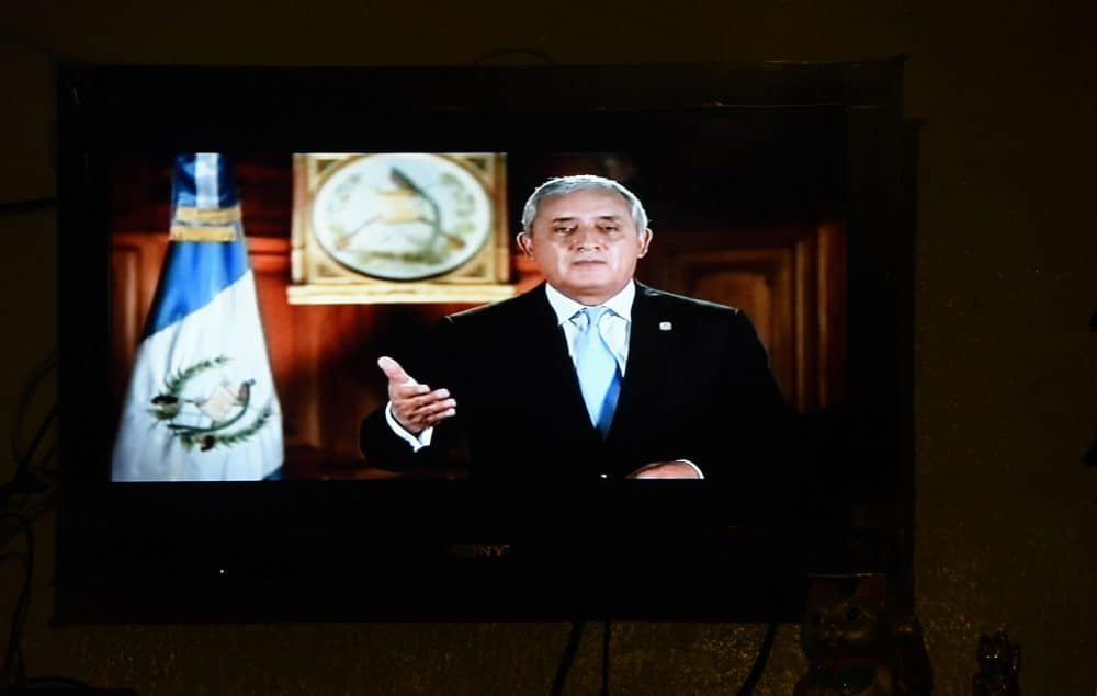 Guatemalan President Otto Pérez Molina's live broadcast is seen at a restaurant in Guatemala City.