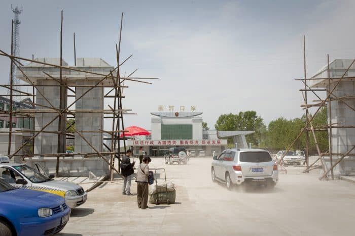 Cars are seen entering a border crossing with North Korea in Quanhe, Jilin province, China.
