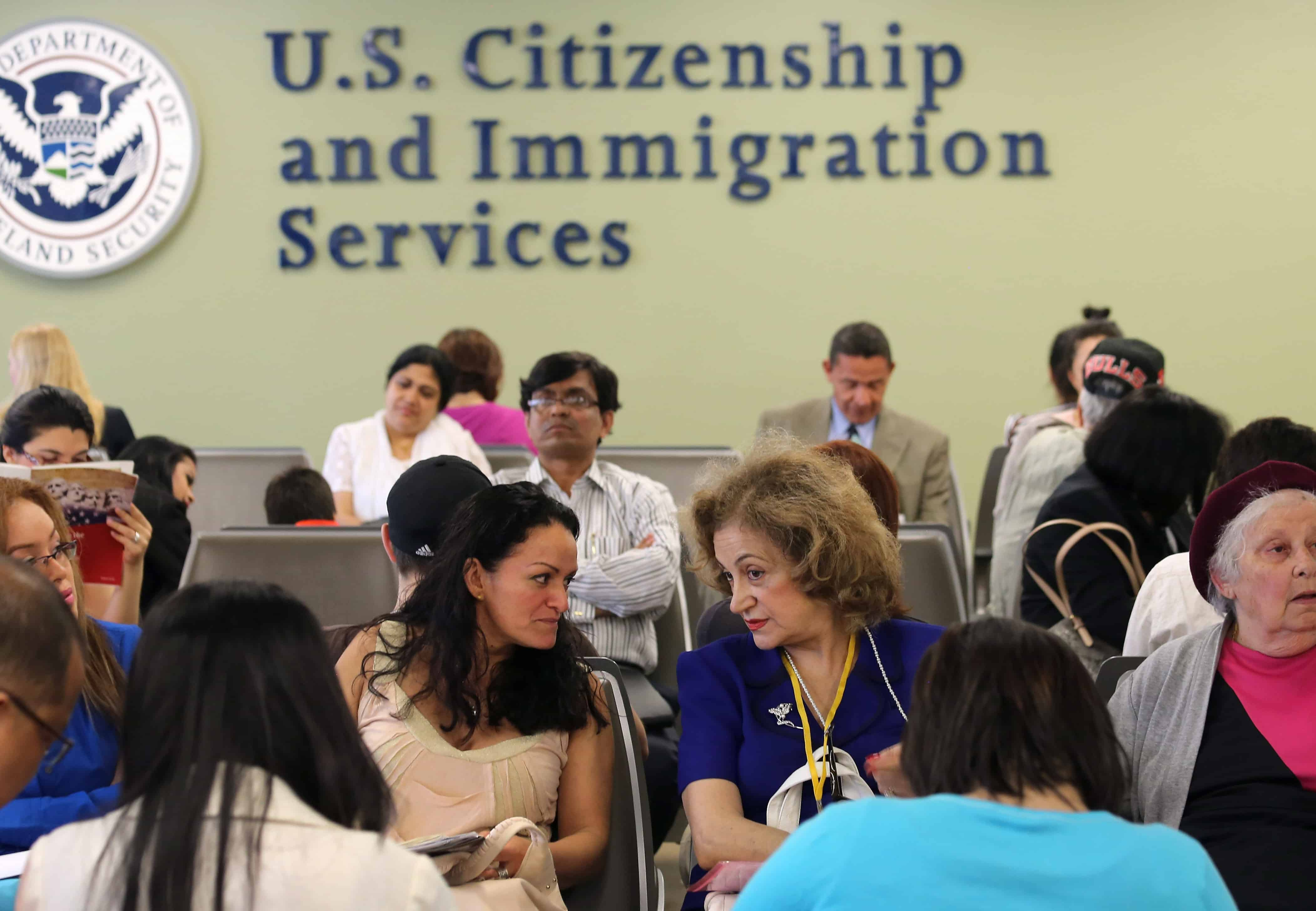 Immigrants await their turn for green card and citizenship interviews at the U.S. Citizenship and Immigration Services office in Queens, NY on May 30, 2013.