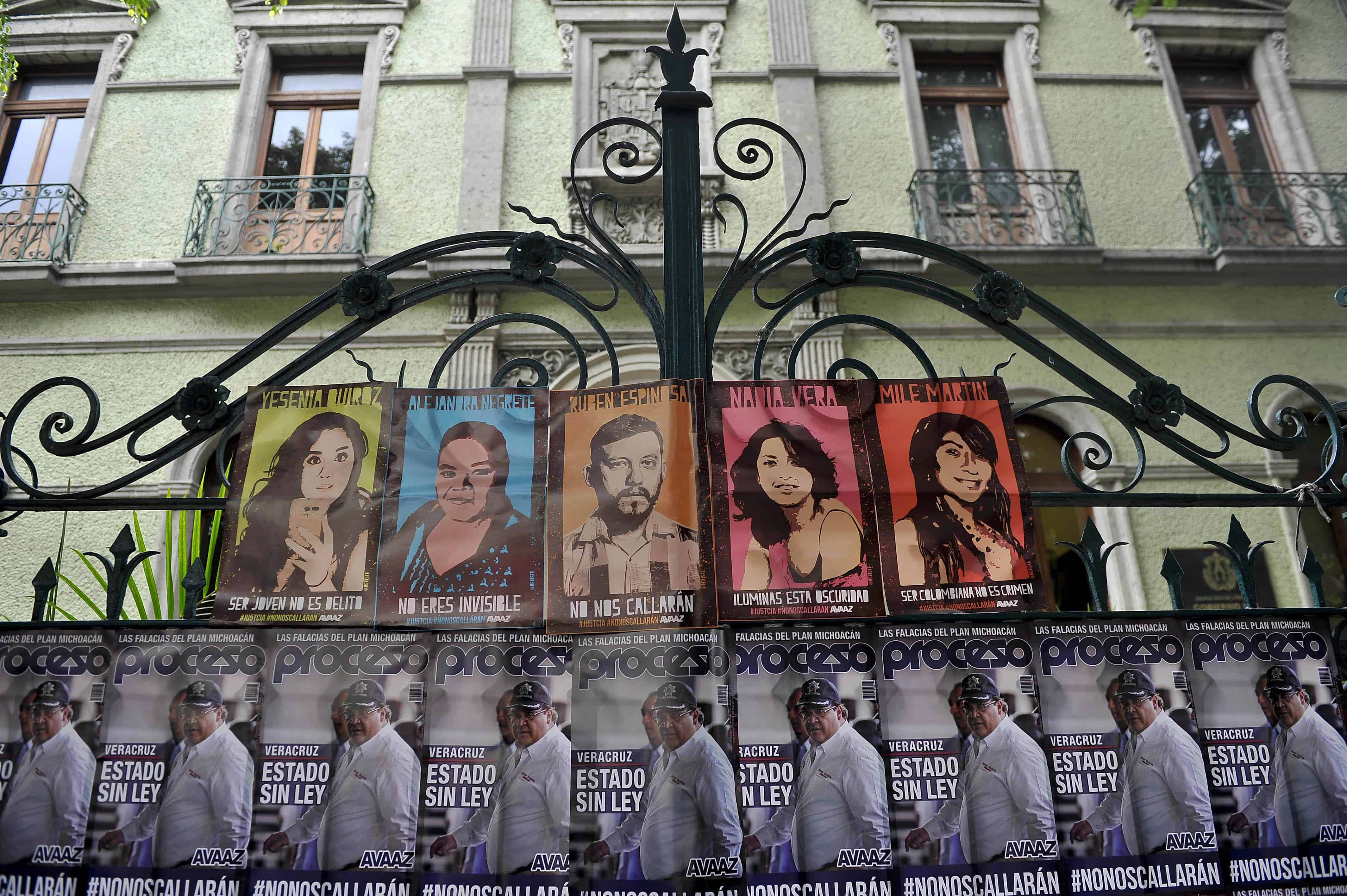 Posters with the image of Veracruz state Governor Javier Duarte (at bottom) and the victims of a horrendous killing hang outside the office of Veracruz state officials in Mexico City on Aug. 31, 2015.