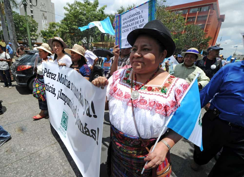 Guatemalan Nobel Peace Prize laureate Rigoberta Menchú, right, takes part in a demonstration.