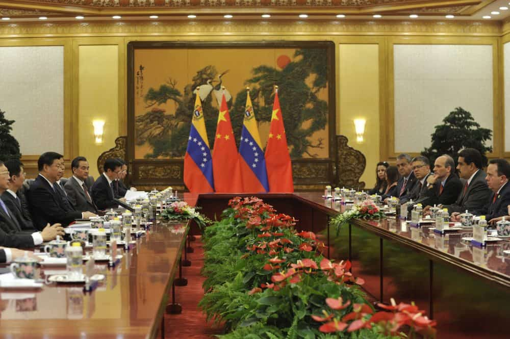 Chinese President Xi Jinping, middle at left, attends a meeting with Venezuela's President Nicolás Maduro.