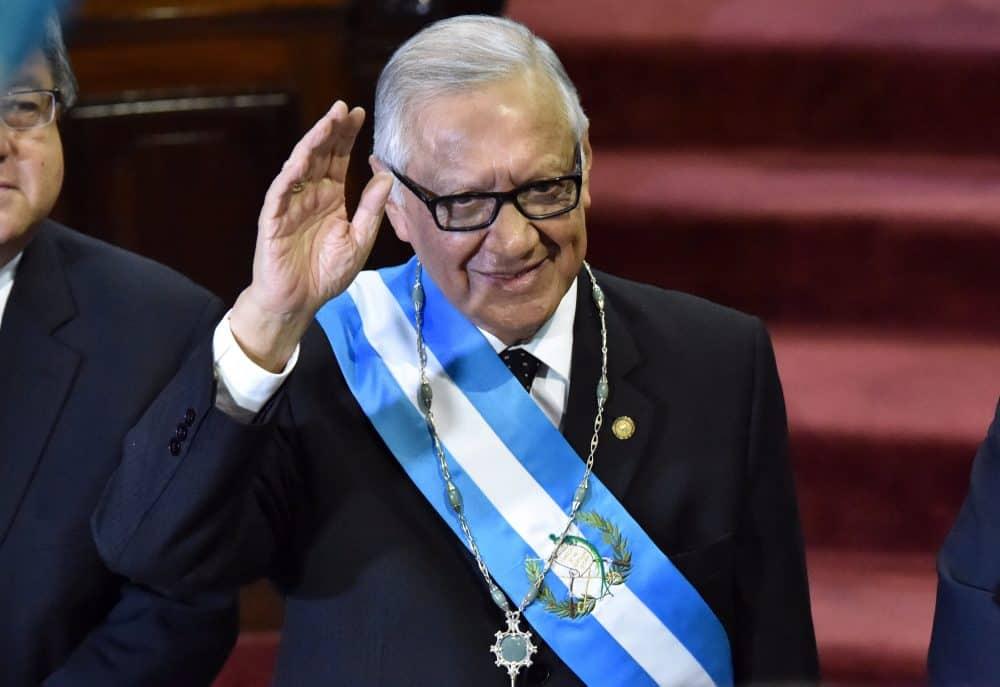 Guatemala's new President Alejandro Maldonado Aguirre waves after being sworn in.