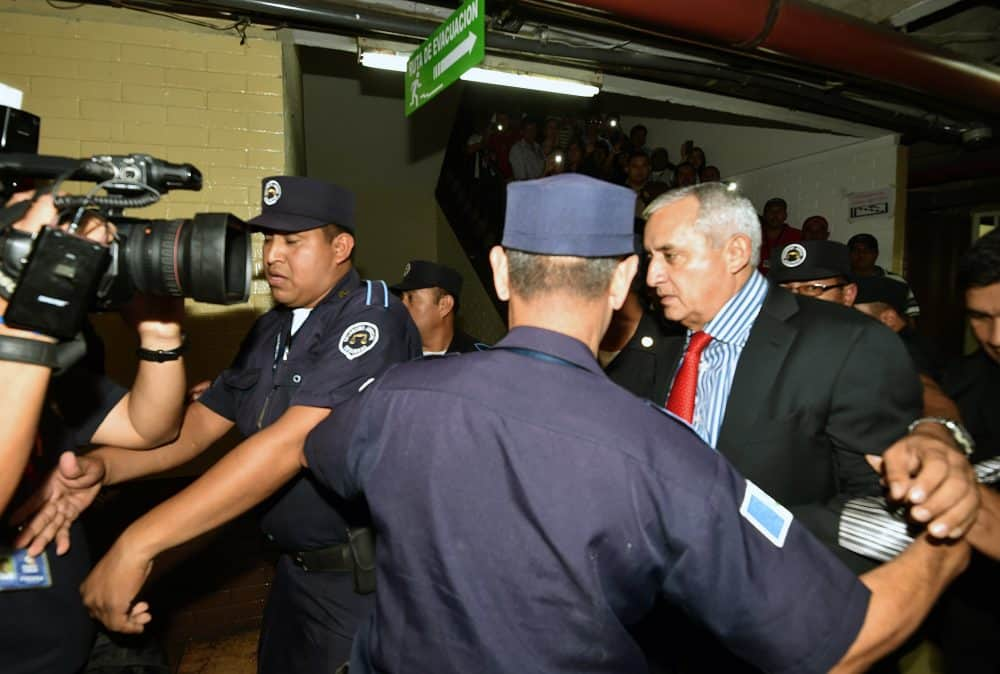 Guatemala's former President Otto Pérez Molina, right, arrives at the Tribunal of Justice in Guatemala City, on Sept. 3, 2015.
