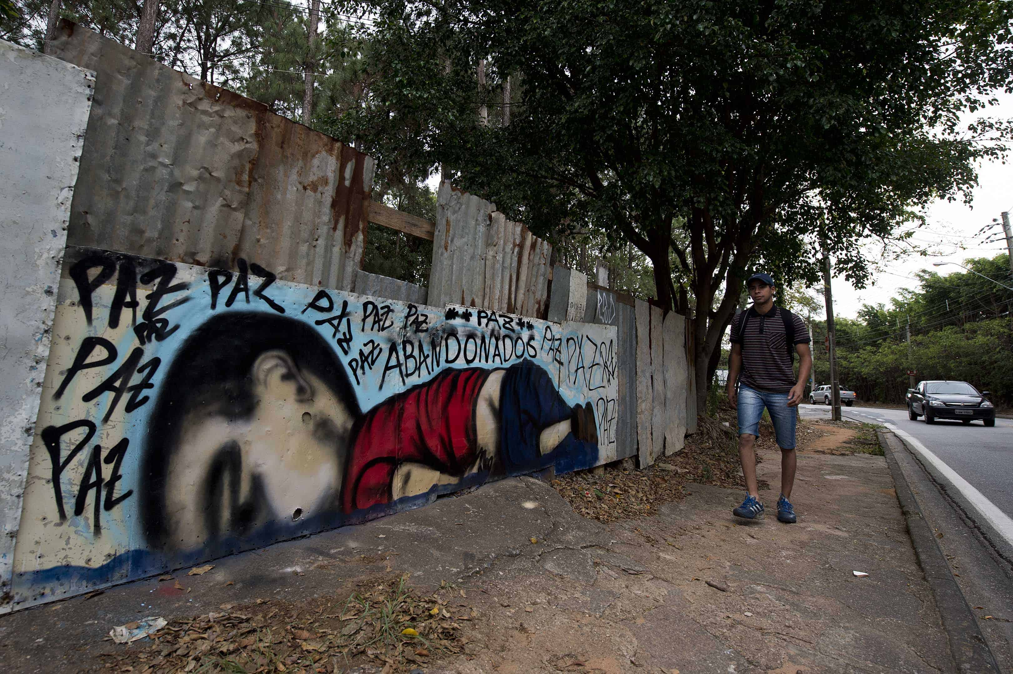 A graffiti depicting Aylan Kurdi, also known as Aylan Shenu, a Syrian 3-year-old boy whose drowning off a Turkish beach, is seen in Sorocaba, some 90 km from Sao Paulo, Brazil, on Sept. 6, 2015.