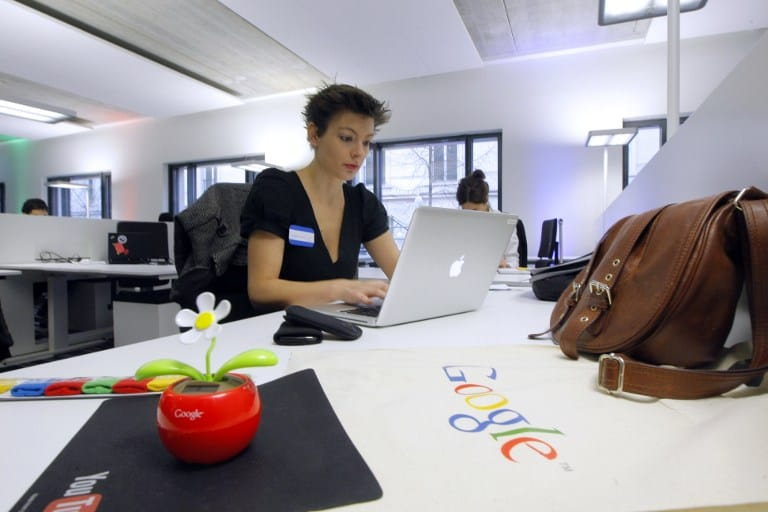 Employees work in the Google France new offices on December 6, 2011 in Paris before its inauguration. AFP PHOTO POOL JACQUES BRINON