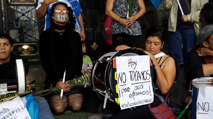 "Guatemalan protesters dress in black on Saturday, Sept. 5 to ""mourn"" the country's general elections on Sunday, which many believe were tainted by ongoing corruption scandals."