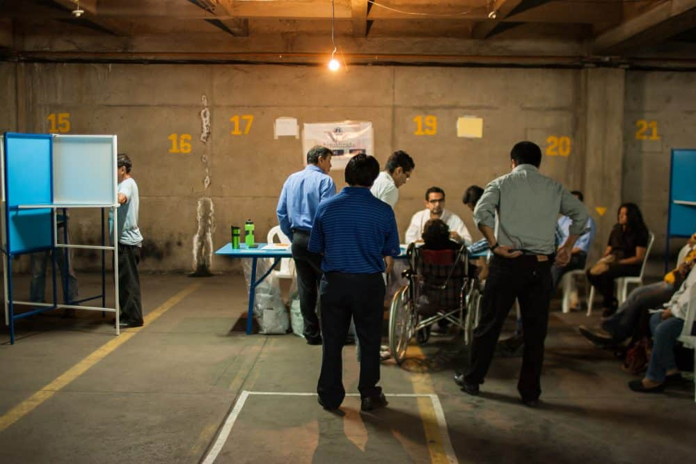 Disillusioned voters cast ballots Sunday, Sept. 6, 2015 in Guatemala in order to have the right to protest later.
