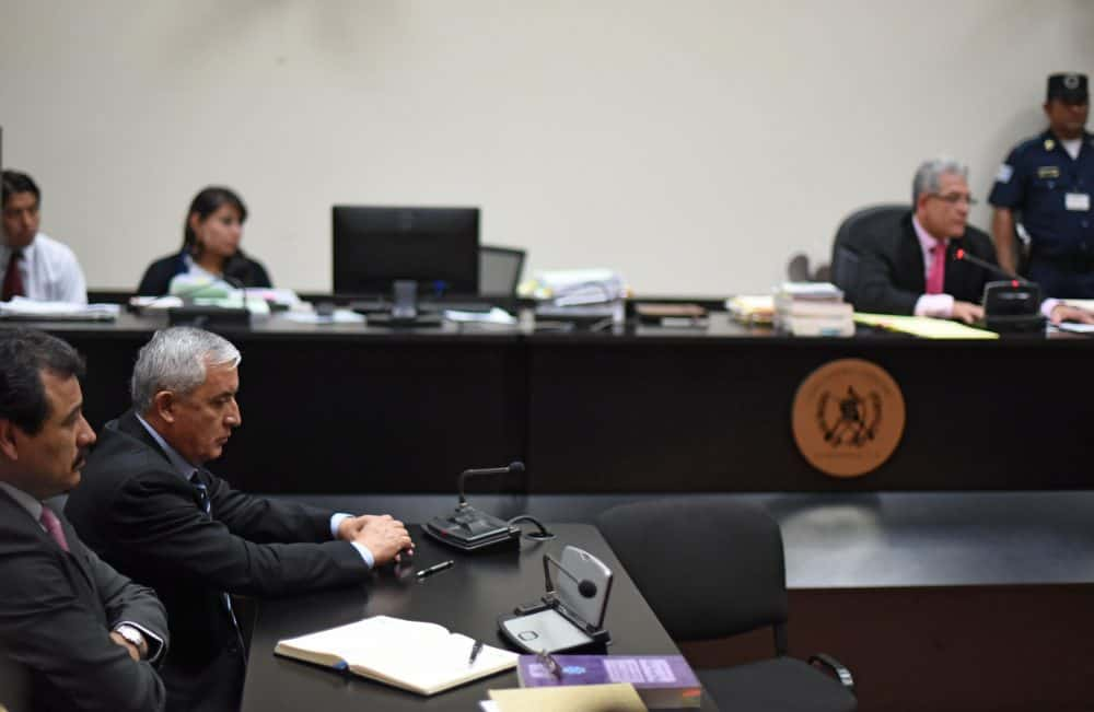 Guatemalan ex-President Otto Pérez Molina, second left, is indicted on corruption charges in a court in Guatemala City, on Sept. 8, 2015.