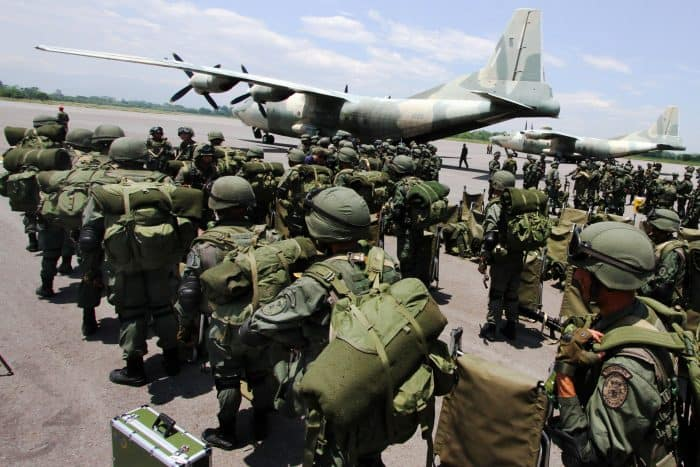 Venezuelan Marines deplane from a Venezuelan Air Force (Chinese-made) Y-8F-100 transport aircraft in La Fria, Tachira state, Venezuela, close to the Venezuela-Colombia border on Aug. 31, 2015.