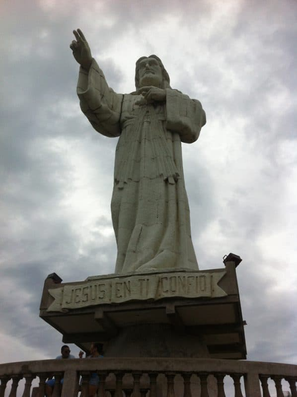"Dos, por favor: The Christ of Mercy statue. The legend says, ""Jesus, in you I trust."""