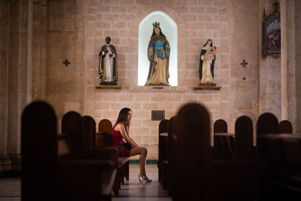 Woman in church in Havana
