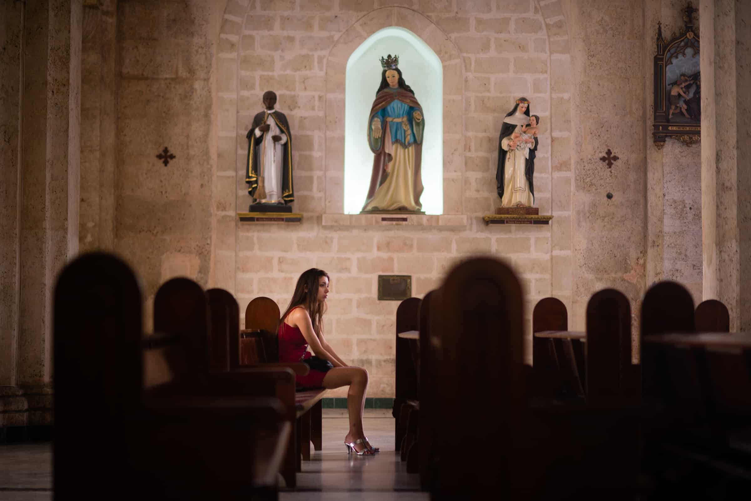 Woman in church in Havana