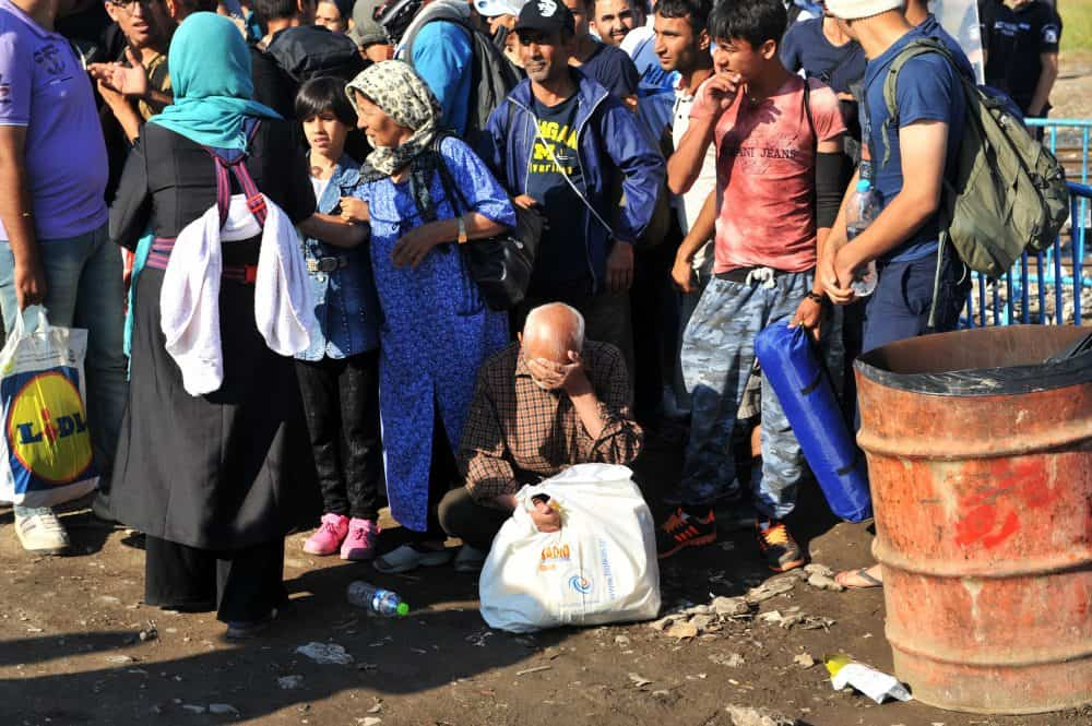Refugees wait to cross the Greece-Macedonia border.