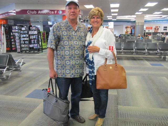 Bernardo and María Perdices at the Miami International Airport Friday, ready to catch a flight to Santiago, Cuba.