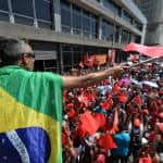 Fitch cuts Brazil credit rating to just above junk