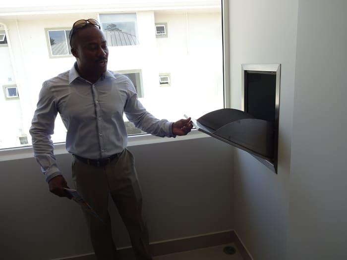 Eduard Morgan shows off garbage chute.
