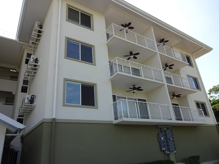 Every condo has a balcony with a ceiling fan.