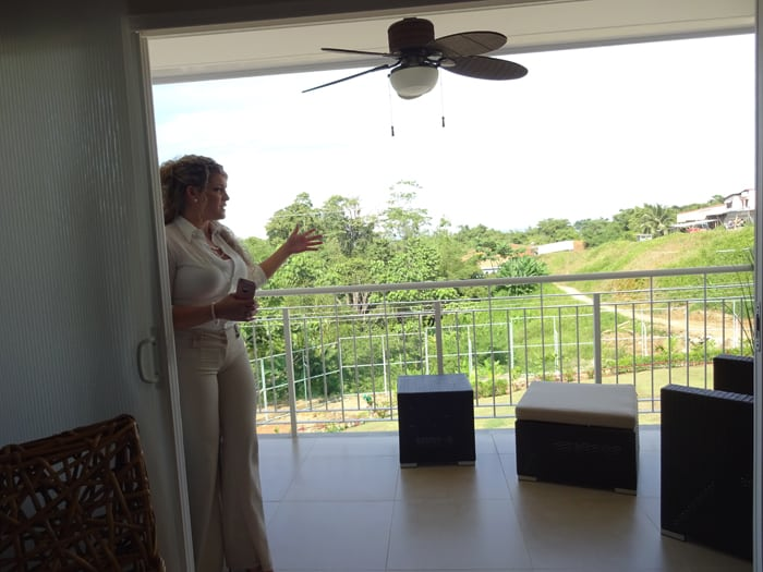 Sales director Wendy Alpizar on a balcony.