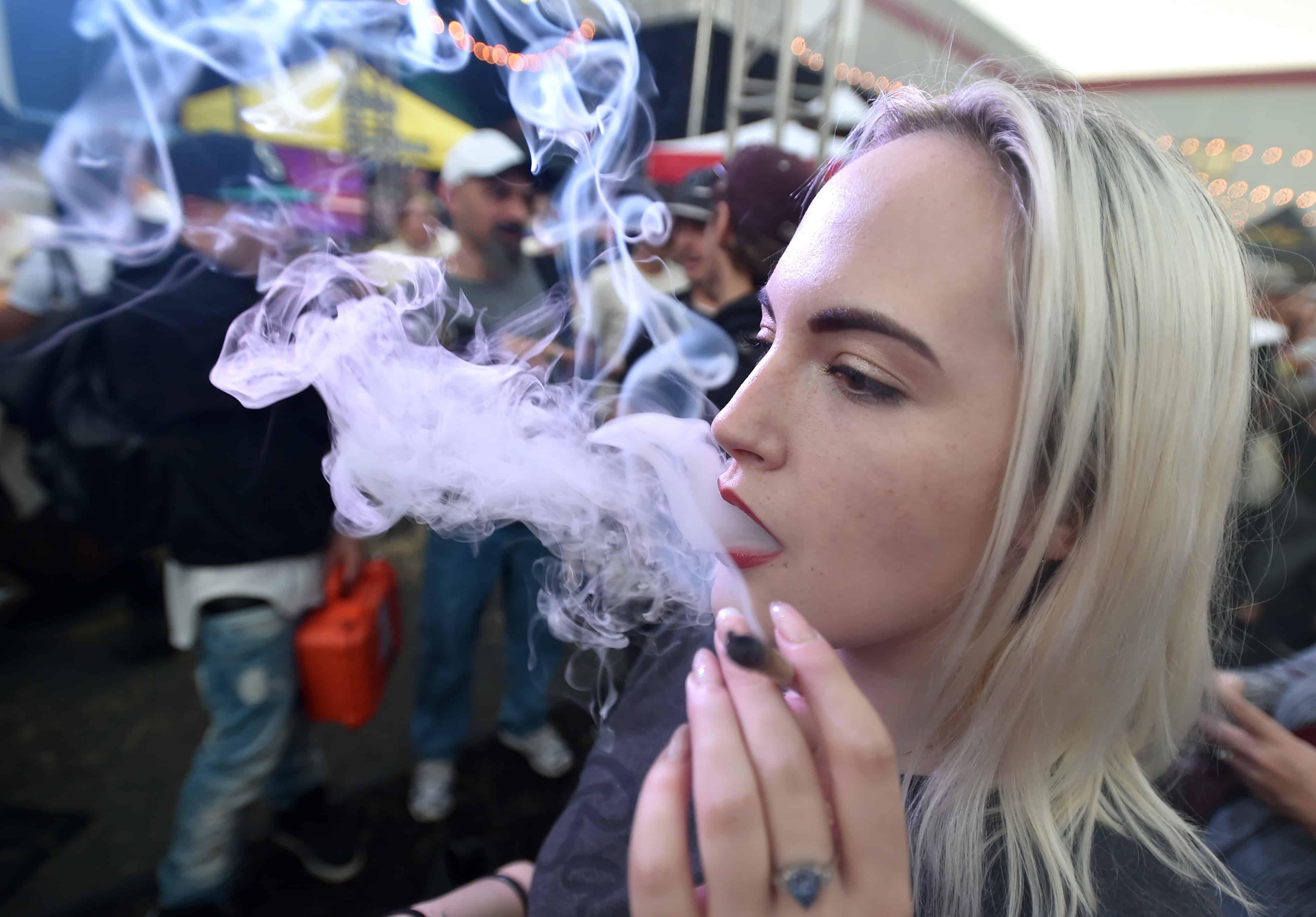 Smoking marijuana at the DOPE Cup.