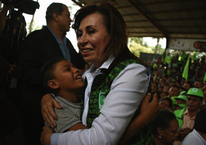 Sandra Torres hugging boy
