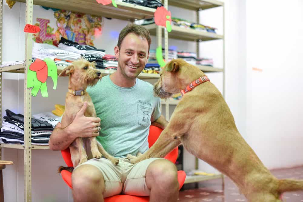 Plivertees owner Oliver Skinner and his two dogs, Radar and Hutch.