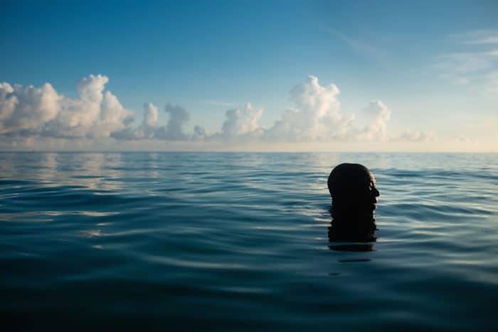 man in water at Punta Frances National Park