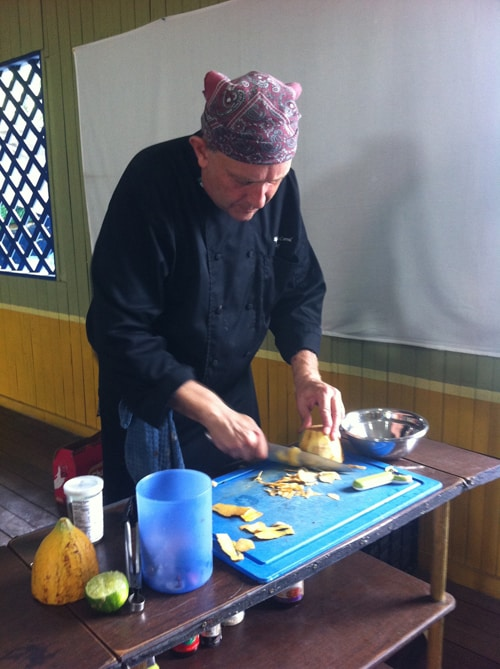 Alejandro Corral slices into a cacao fruit.