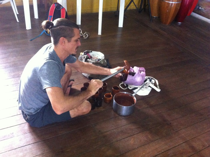 Cups of chocolate being poured for a Cacao Ceremony.