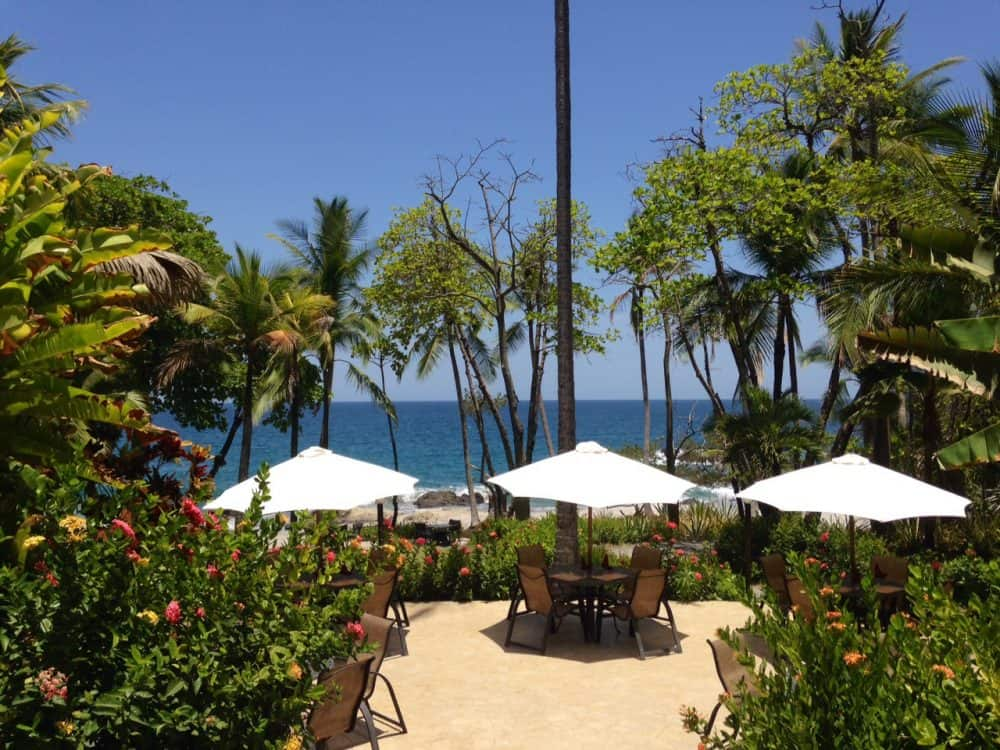 Oceanfront patio at Ylang Ylang Beach Resort