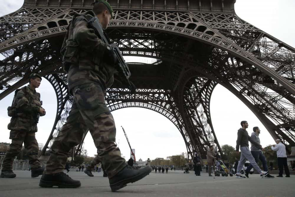 Soldiers patrol at the foot of the Eiffel Tower in Paris