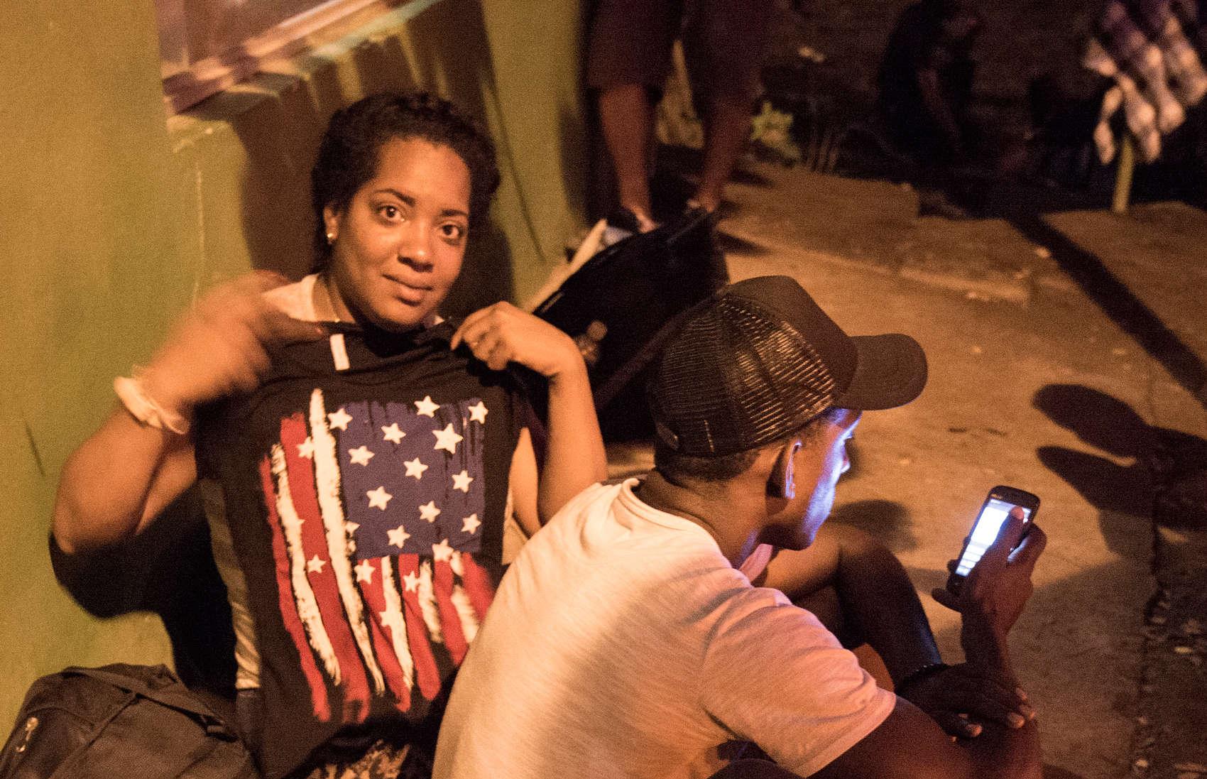 Cuban migrant holds U.S. flag