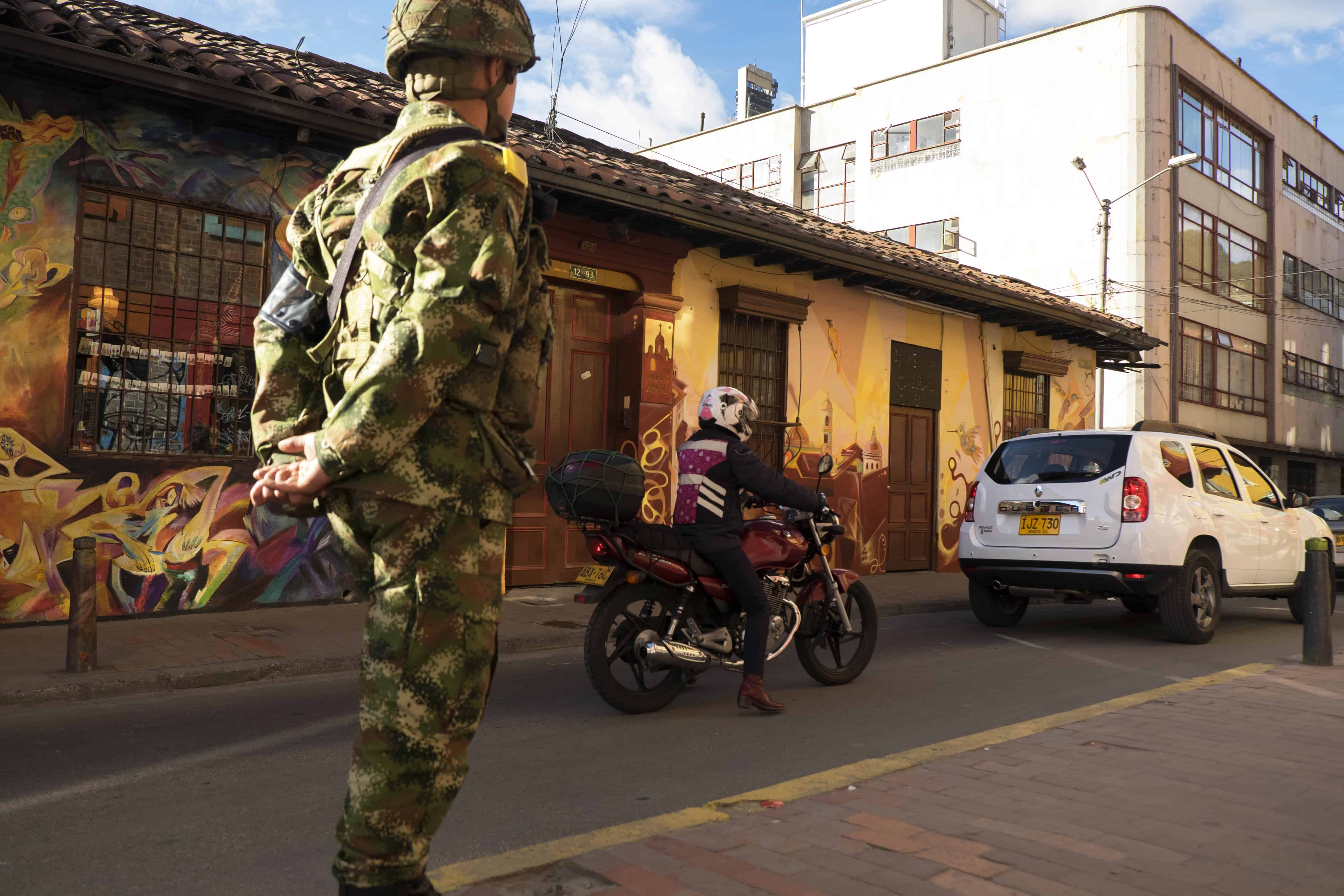 Colombia military: A soldier walks through the touristic area of Candelaria, Bogota.