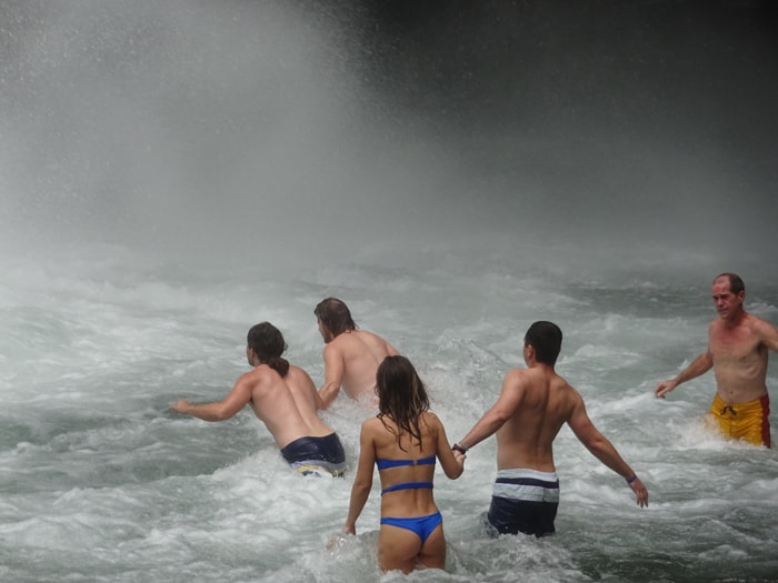 From left: Orpheus, Aladdin, girl in blue bikini, boyfriend of girl in blue bikini and travel writer stagger toward the base of La Fortuna Waterfall.