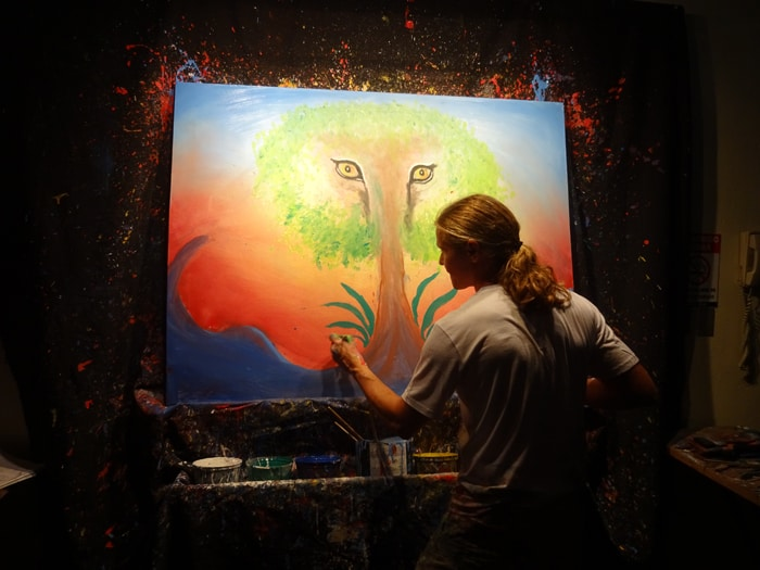 Argentine painter /performance artist Carlos Hiller creates a painting while dancing to live music.