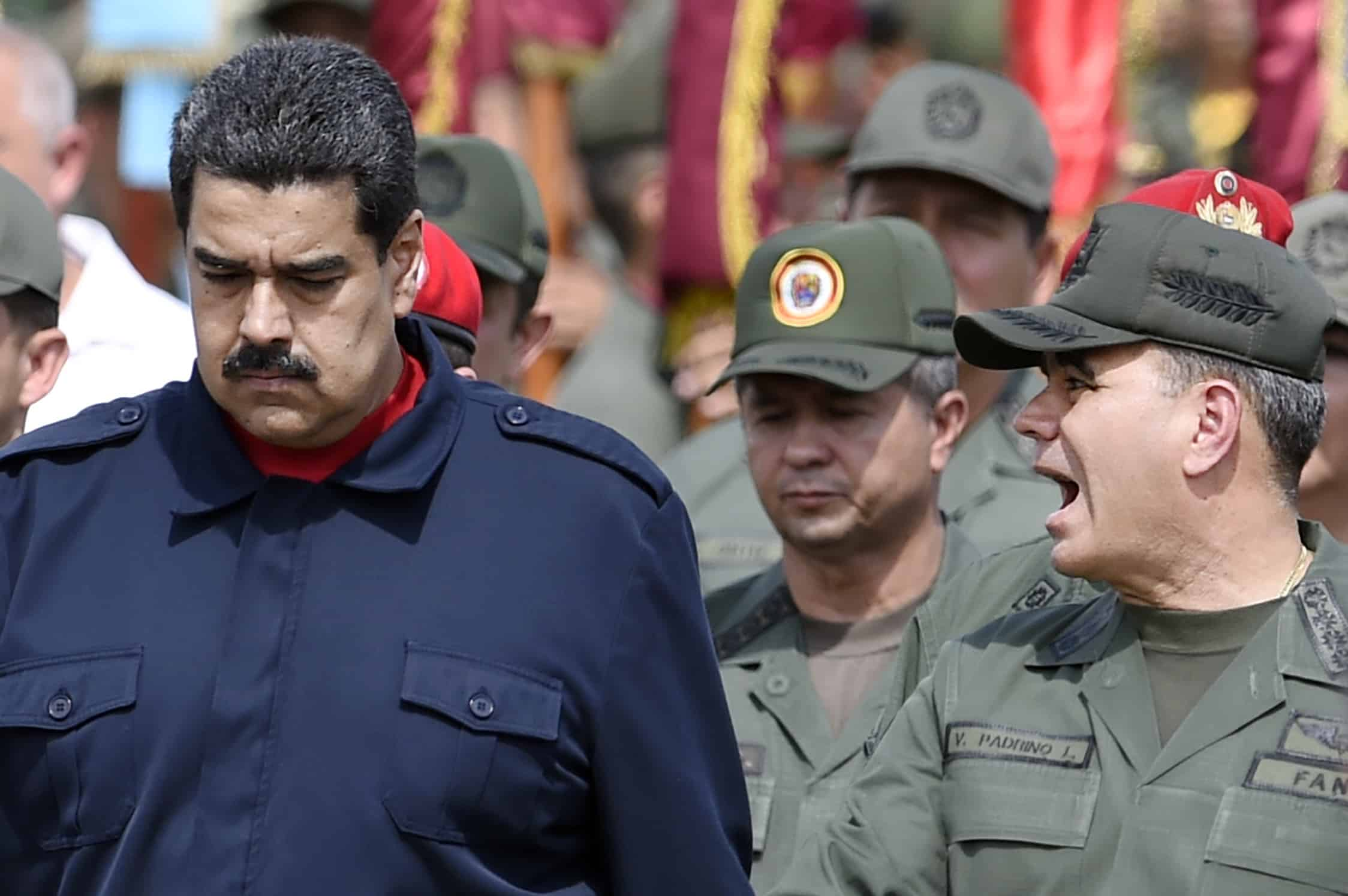 Venezuela President Nicolás Maduro, left, walks with Venezuelan Defense Minister Padrino López