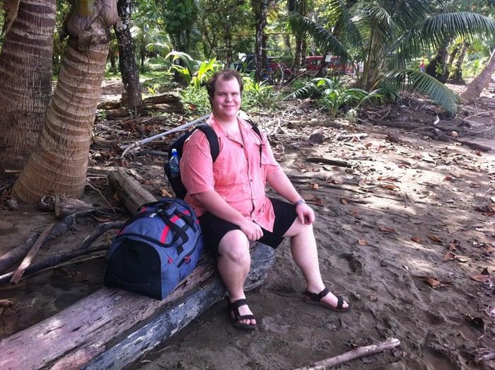 Jordan awaits boat pickup at Drake Bay.