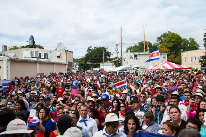 crowds of ticos gather in september in bound brook new jersey to welcome costa rica president luis guillermo sols
