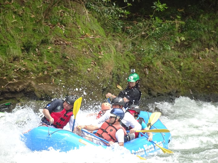 Costa Rican President Luis Guillermo Solís, left, rafts the Pacuare River.