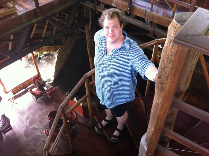 Jordan on the spiral stairs in the big rancho at Lapa Ríos.