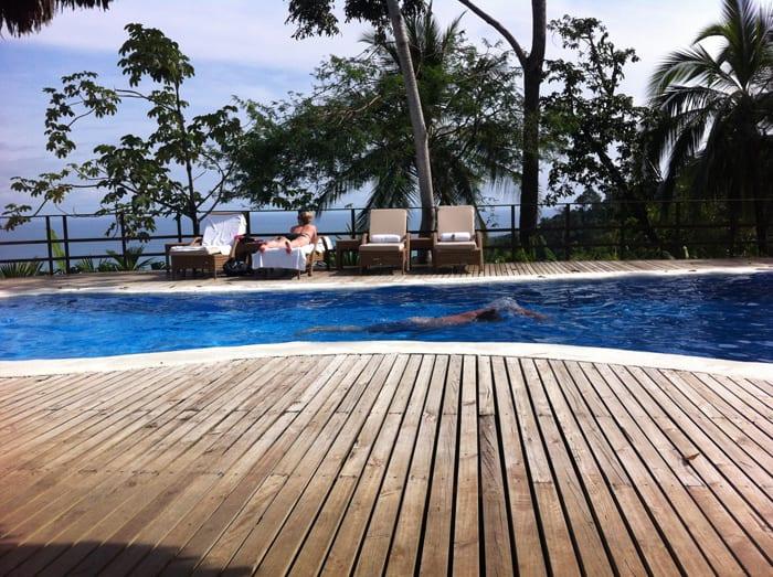 Jordan swims laps in the pool at Lapa Ríos.