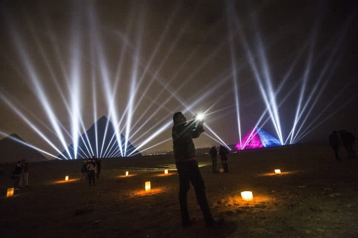 Egyptians celebrate the New Year in front of the pyramids