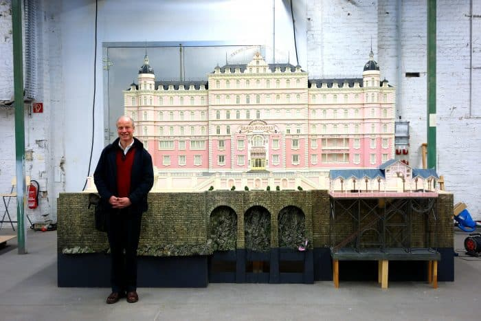 Carl Sprague along with his Grand Budapest Hotel design. [Courtesy of FID]