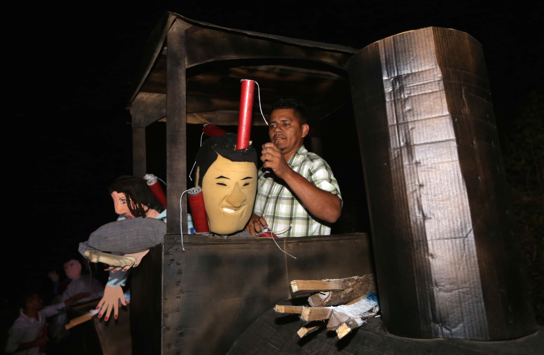 a dummy depicting Honduran President Juan Orlando Hernández