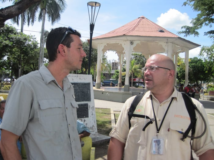 Tour guide Erick Weissel and Tourism Professor Josué Duarte Montes in front of the Gazebo in the Parque Central.