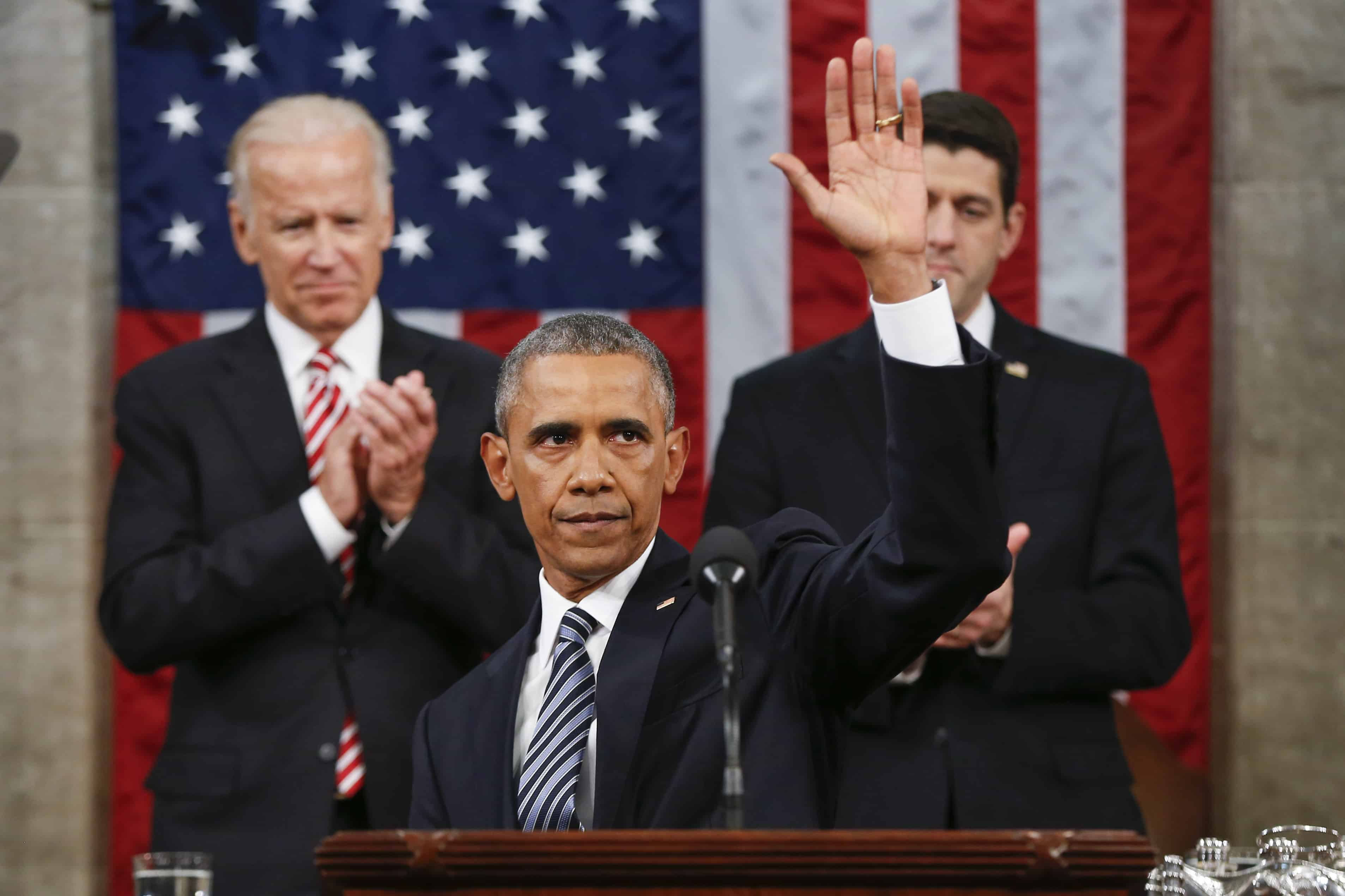 U.S. President Barack Obama waves at the conclusion of his State of the Union address
