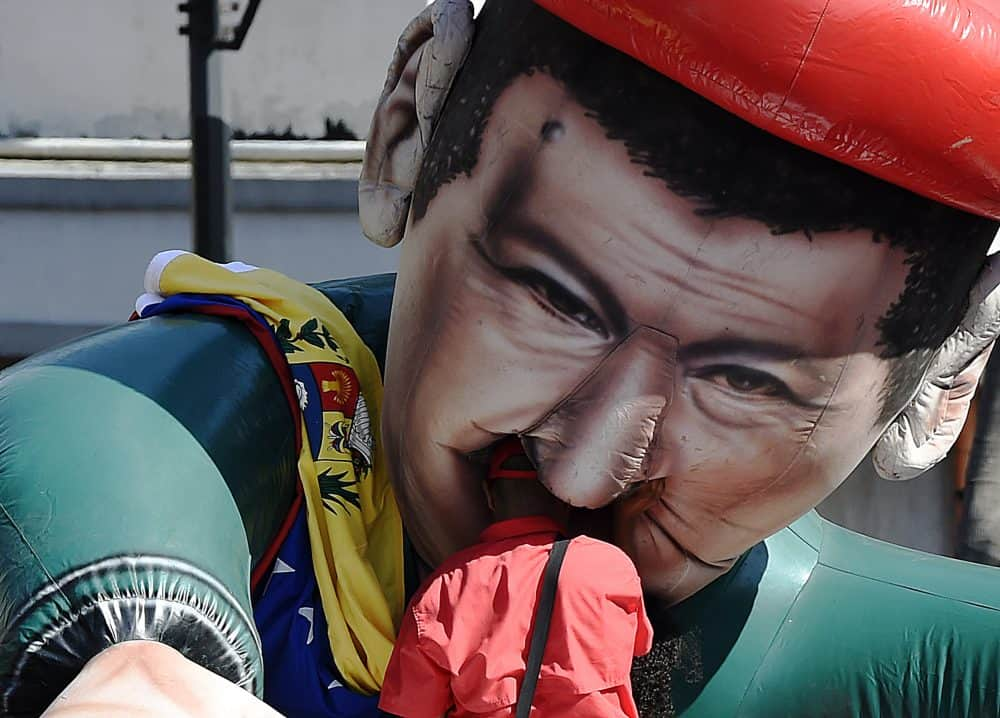 Venezuela crisis: A man and an inflatable doll depicting late Venezuelan President Hugo Chávez
