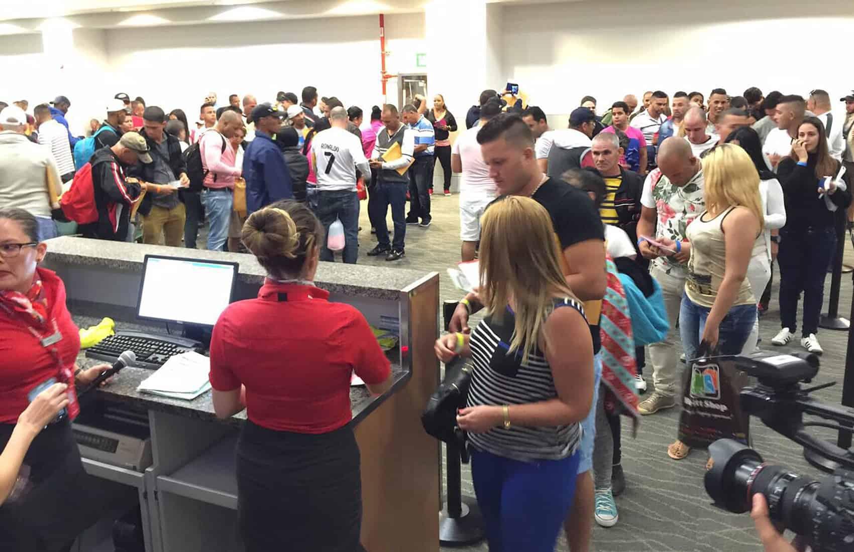Cuban migrants at Daniel Oduber International Airport in LIberia