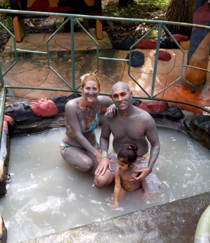 Looking a bit like the Blue Man Group, a family from Florida enjoys a mud path at Blue River Resort.