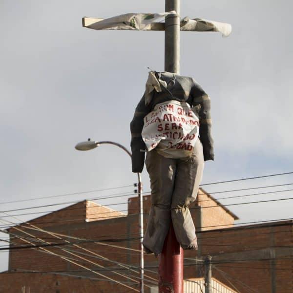 Peru vigilantes | Bolivia hanging doll